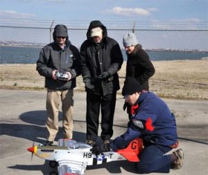 NRL scientists prepare for the launch of a RC P-51 replica using fuel derived from seawater. Credit: U.S. Naval Research Laboratory