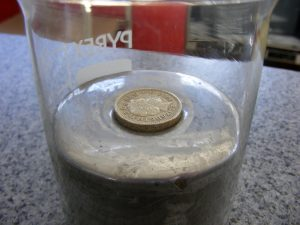 Coin Floating on Liquid Mercury, a Heavy Metal (Alby)