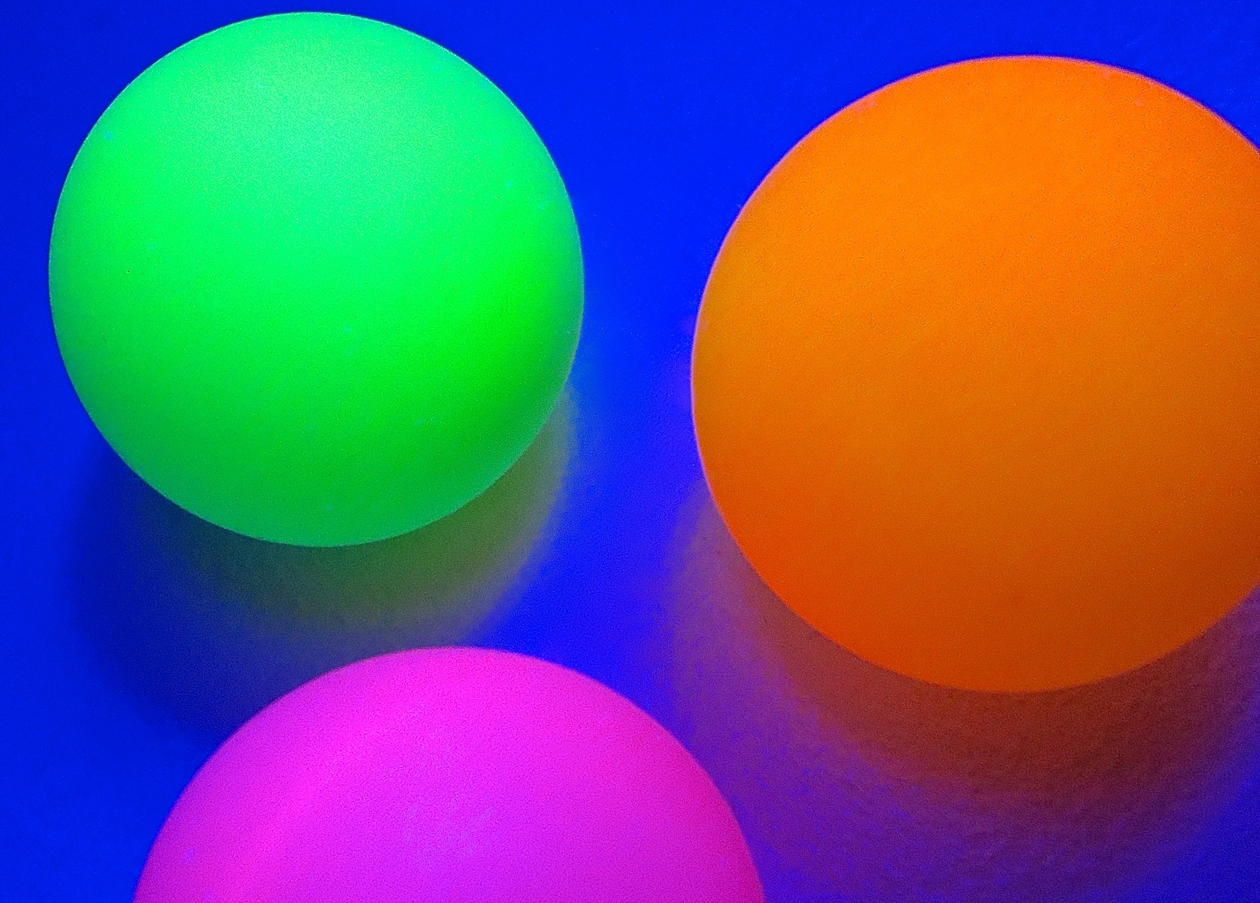 Ping Pong Balls Under Black Light (Dean Hochman)