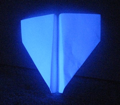 White Paper Glows Blue Under UV Light