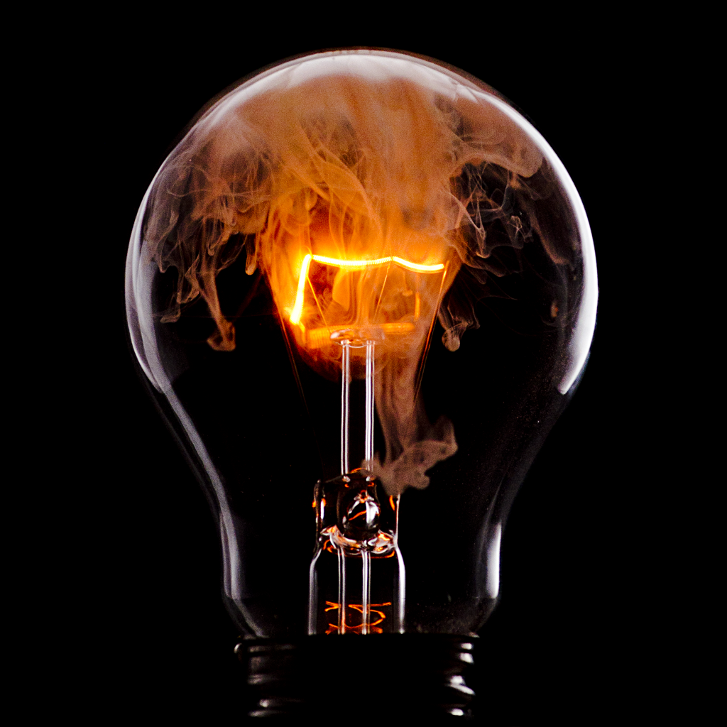 The incandescent light bulb glows when current passes through the filament and heats it enough to release light. (photo credit kessLflickrZ)