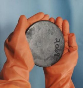 Uranium is a silvery-white metal. Photo is a billet of highly enriched uranium recovered from scrap processed at the Y-12 Facility in Oak Ridge, TN. U.S. Department of Energy
