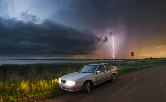 Lightning and a car. Photo Credit: Bryce Bradford