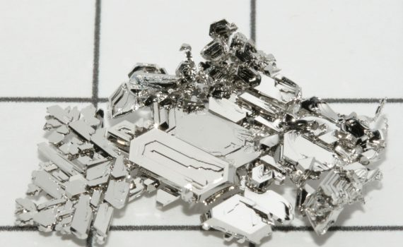 Platinum is a dense, grayish-white transition metal. These crystals of pure platinum were grown by gas phase transport. (Periodictableru)
