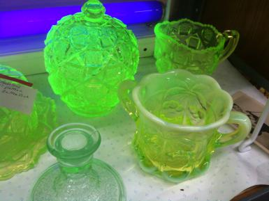 Uranium glass exhibits a characteristic green fluorescence under black or ultraviolet light. Nerdtalker, Creative Commons License