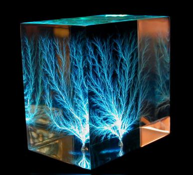 This Lichtenberg figure was made by shooting a beam of electrons (~2.2 million volts) through an insulator. The pattern is illuminated by blue LEDs. (Bert Hickman, Wikipedia Commons)