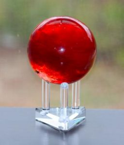 This sphere of cinnabar in quartz may be considered to be a form of red mercury. Cinnabar or vermilion is red mercury(II) sulfide.