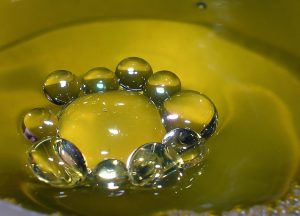Antibubbles consist of a liquid drop surrounded by a layer of gas, as opposed to normal bubbles in which a liquid film surrounds a sphere of gas.