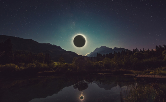 Total Solar Eclipse Over a Lake