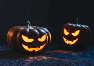 The self-carving pumpkin demonstration involves carving a jack-o-lantern face using an explosive chemical reaction.