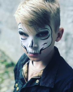Use white face paint and black eyeliner to make a simple skeleton costume.