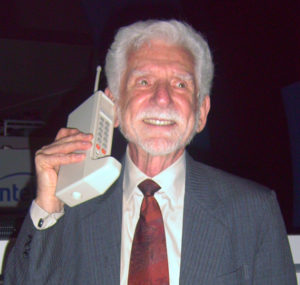 Martin Cooper and the prototype DynaTAC cellphone.