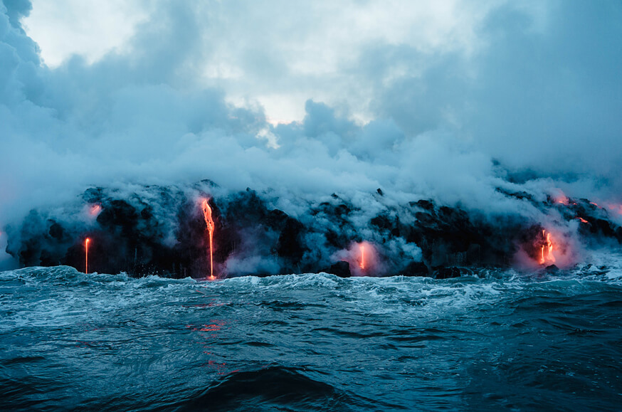 Lava meets ocean to produce steam.