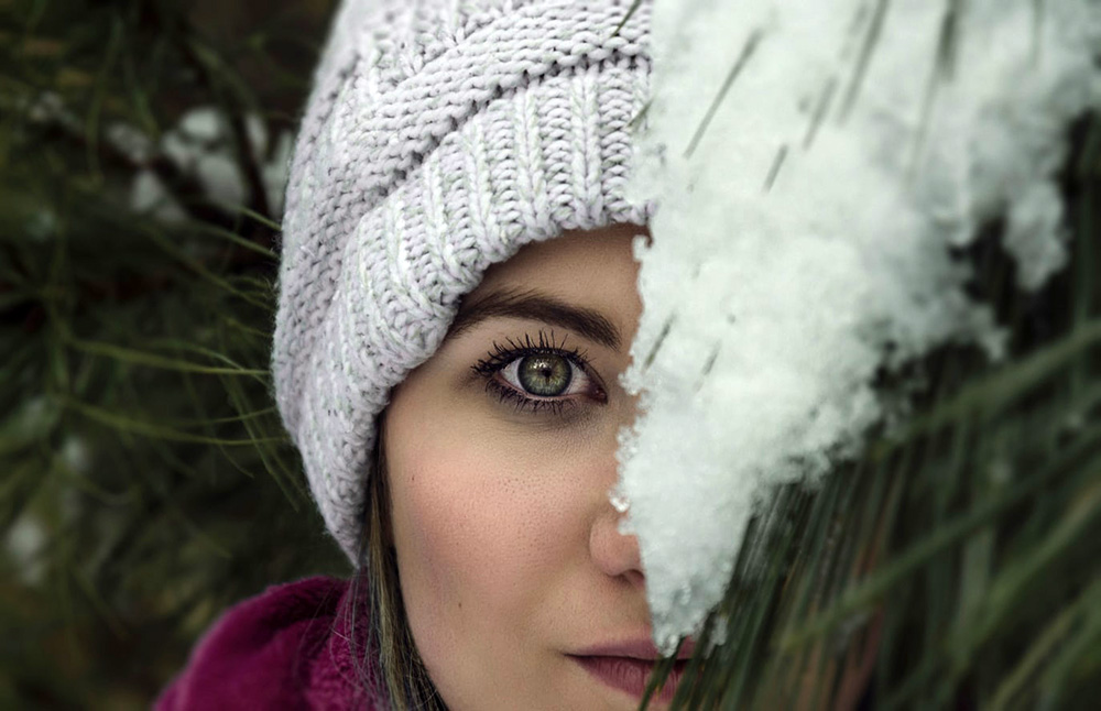 Girl smelling snow (Taylor Boggs)
