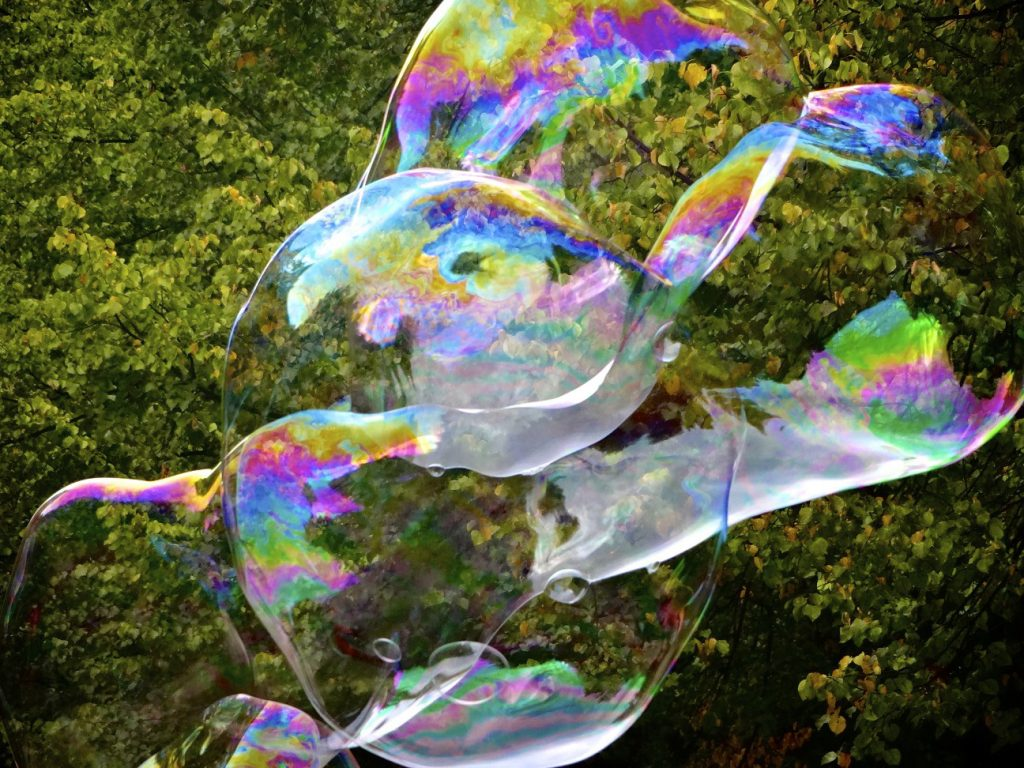 Make giant bubbles using a special bubble recipe and a larger bubble wand.