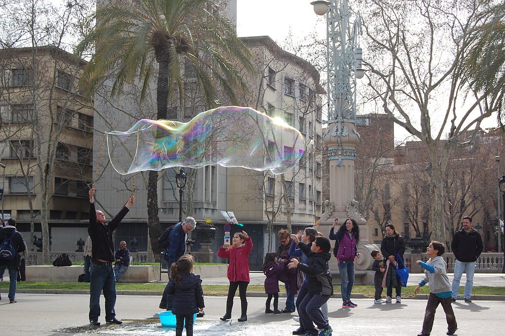 Example of how to use a dowel and rope giant bubble wand.