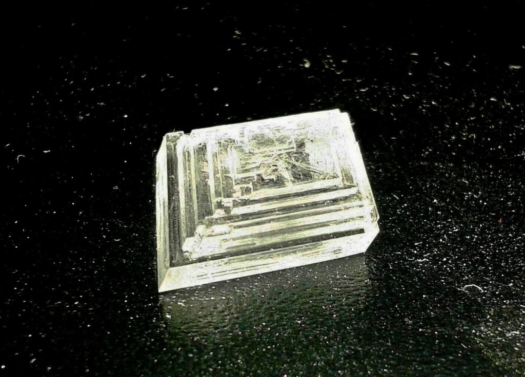 Sodium nitrate crystals grow Hopper (step-ladder) faces in the trigonal system.
