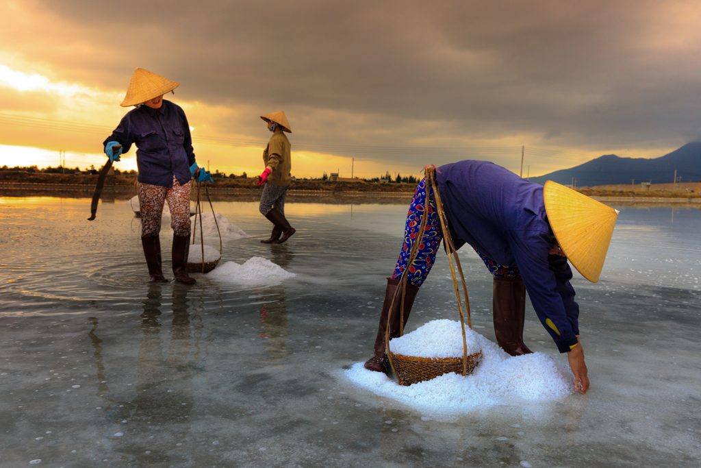 These women separate sea salt from sand and water by letting the sun evaporate the water.