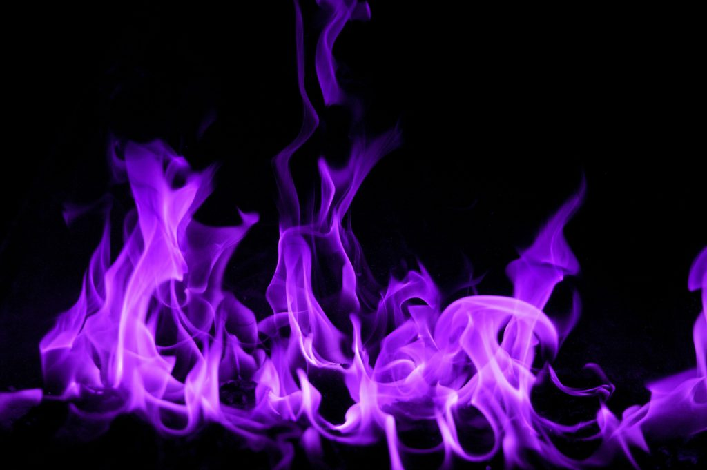 Purple flames come from metal salts, such as potassium and rubidium.