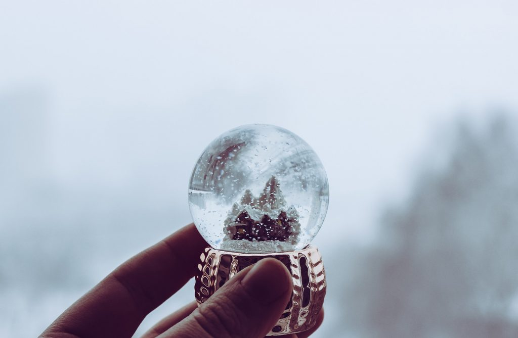 Benzoic acid crystals are perfect for a snow globe because they sparkle like snowflakes but don't melt.