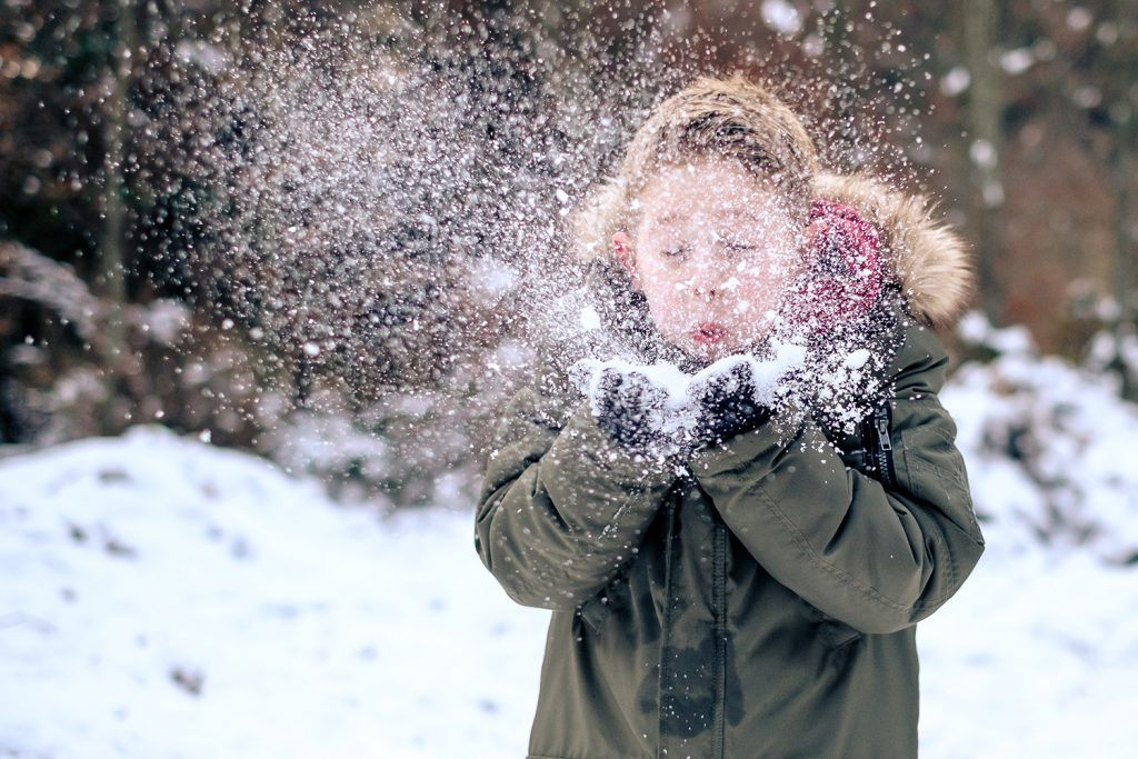Boy Playing With Real Snow